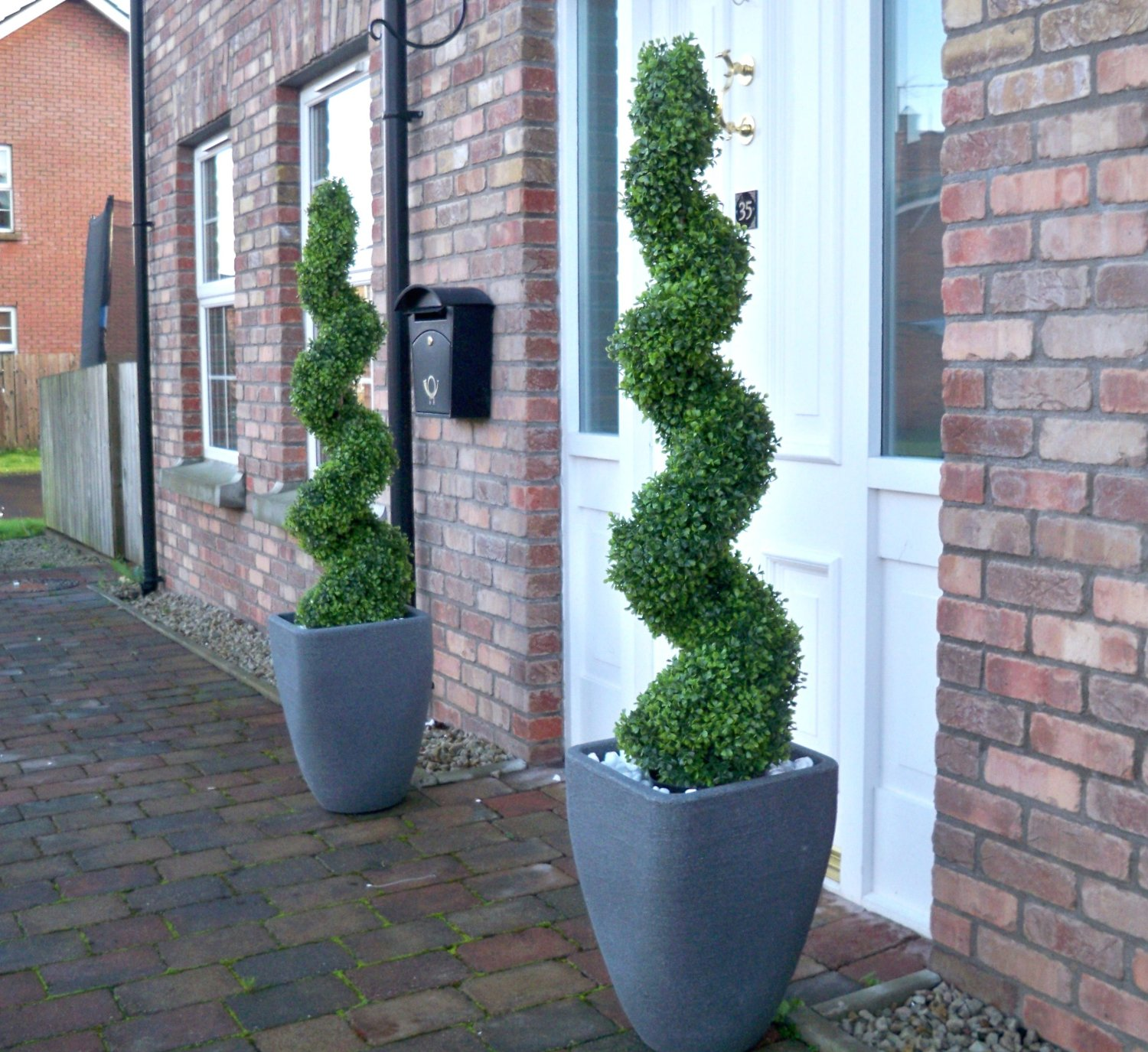 pair of artificial boxwood buxus topiary spiral trees (120cm - 4ft Artificial Topiary Trees