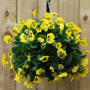 Yellow artificial pansy hanging basket