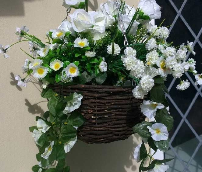 Lovely artificial hanging basket with tumbling white flowers the artificial hanging basket with white flowers mightylinksfo