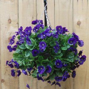 Artificial purple pansies hanging basket