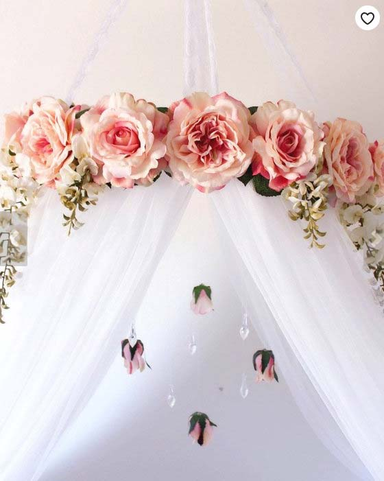 Artificial flowers on a bed canopy