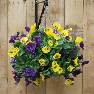 Artificial hanging basket with blue and yellow pansy flowers