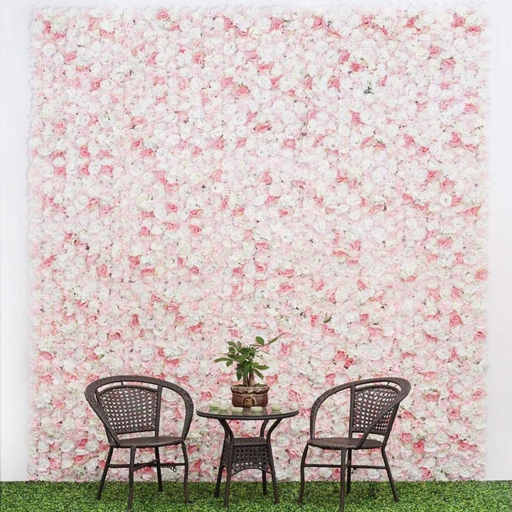 Flower wall behind chairs